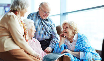elderly people having conversation