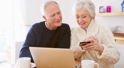 elderly couple using laptop