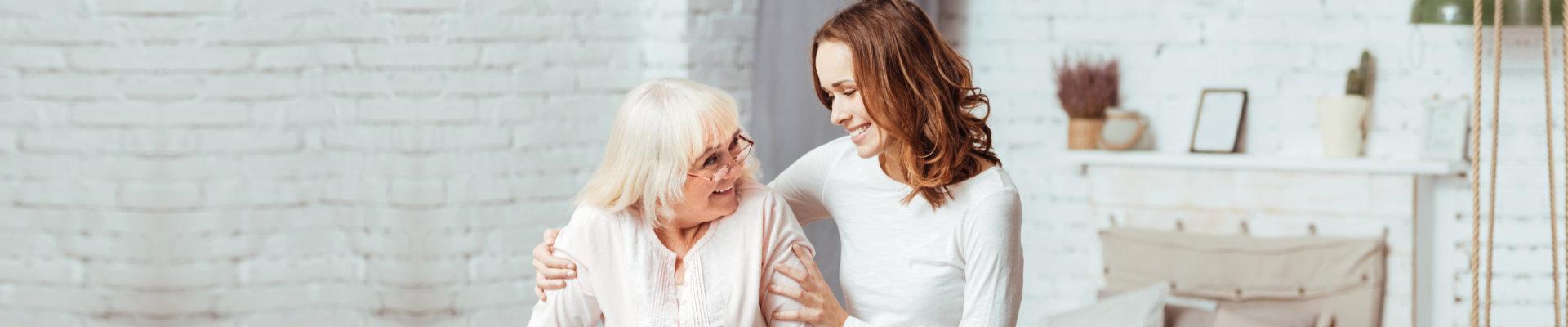 caregiver assisting an elderly lady